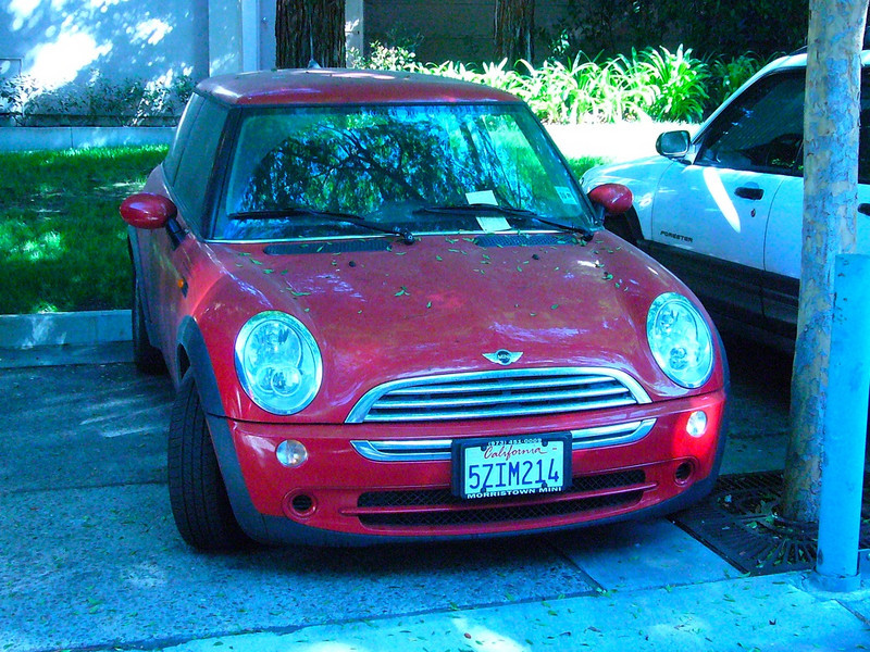 Red Mini Cooper in front of building 475 296968313_mxQWN-L