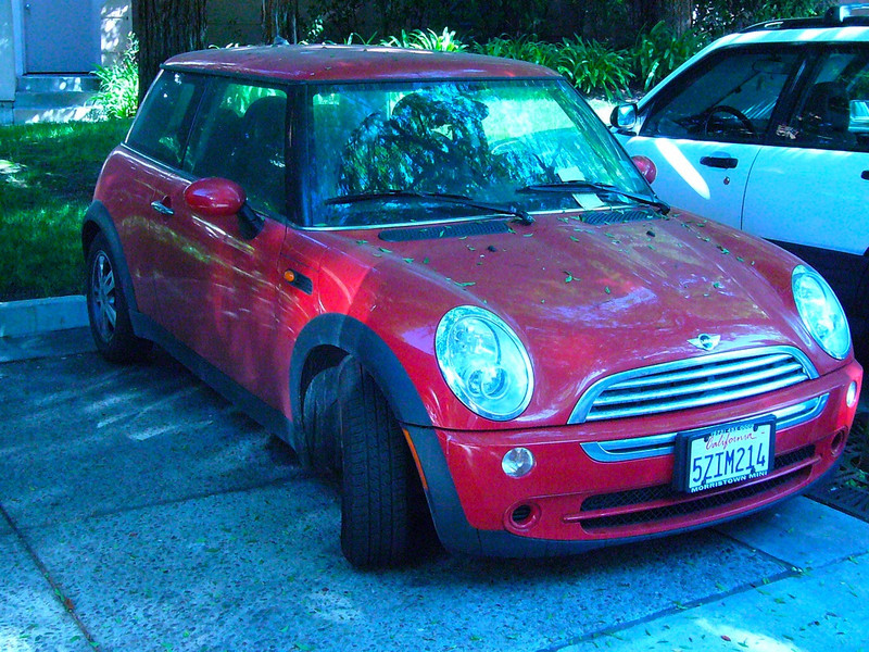Red Mini Cooper in front of building 475 296968338_LVJaw-L